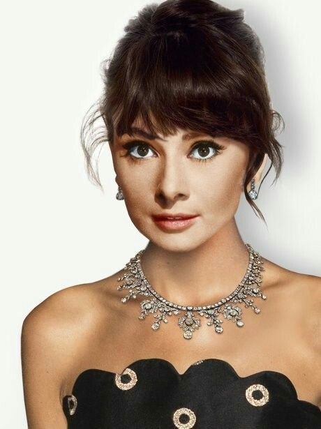 Audrey Hepburn in a rhinestone statement necklace.