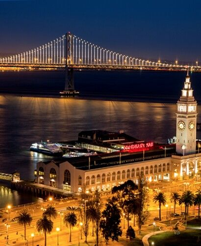 I love this picture of SF with the Bay Bridge lit up!