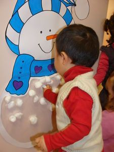 this could be a cute seasonal interactive wall-leave glue and cotton balls to fill in the snowman!