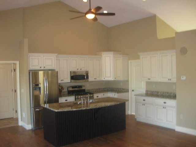 Kitchen with Ivory and espresso colored cabinets, granite tops