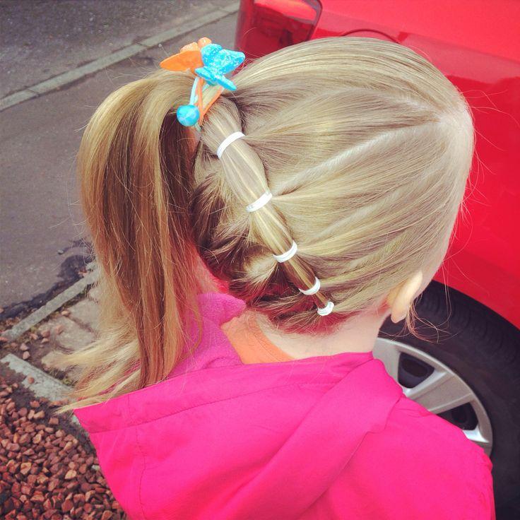 Little girls hair do.. Lots of elastics hold better than braiding !