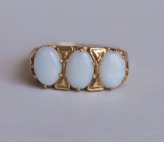 Vintage yellow gold ring with 3 white opals 0.47 ct each by Irera