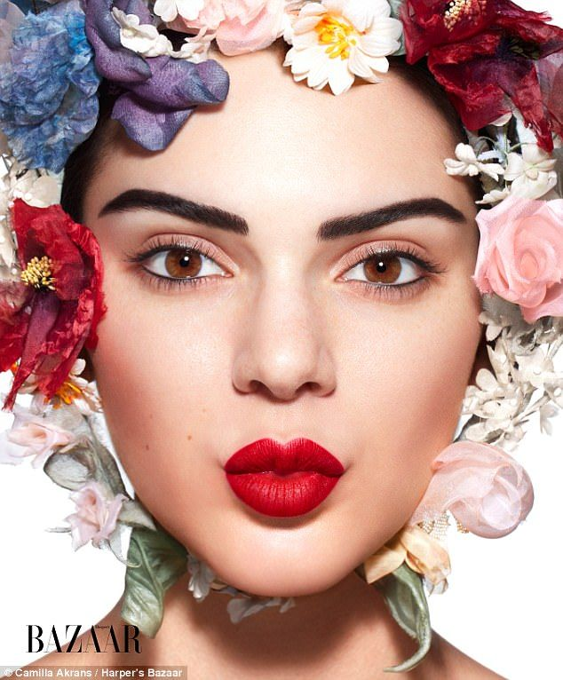 Flower power: The 22-year-old model looked fantastic rocking aDior Haute Couture headpiece featuring several flowers