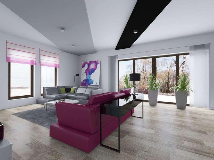 Nowoczesny salon z akcentem w postaci różowej kanapy.