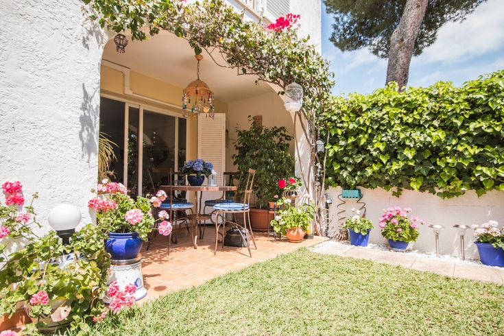 Lovely townhouse and garden in Portals. Barbara will not trade it for anything. Read more in our blog.
