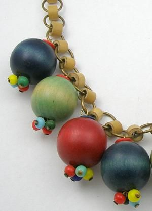 Description: 1930's early Miriam Haskell unsigned necklace, an excellent example of use of Czech wood beads. Large stained wood beads, two each of red, ...