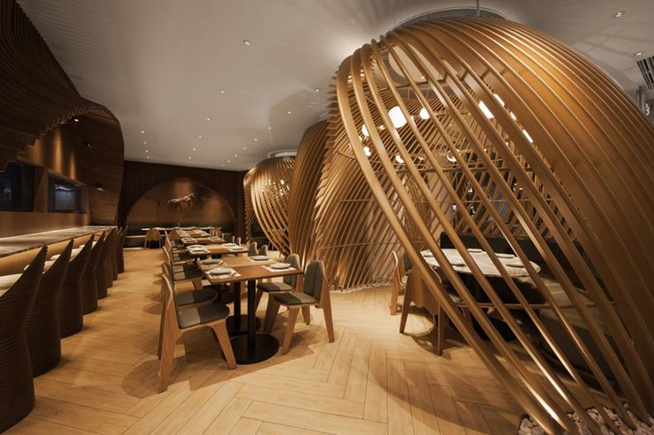 Sit Inside Fishing Basket Inspired Curvilinear Structures At This Restaurant | CONTEMPORIST
