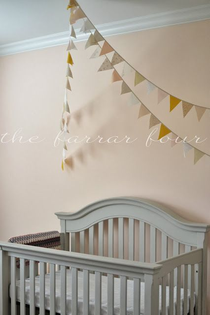 The Farrar Four Pennant Banner over crib, grey crib, whispering peach paint color, peach nursery, girl nursery