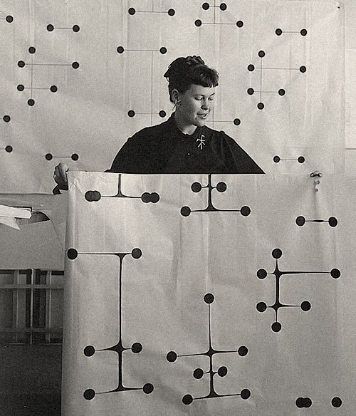 pjmix:  Ray holding Dot Pattern Fabric Design, circa 1947, photograph. (via Eames Office Resources - Charles and Ray Eames)