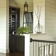 tropical wine cellar by Brown Contractors Fine Custom Homes