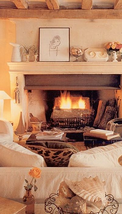 Large fireplace in cosy living room
