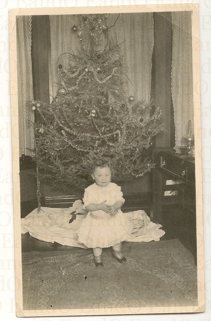 """Vintage Christmas Photo ~ Little girl in front of their lighted Christmas tree. The back is inscribed, """"Your second Christmas. Our first electric lighted Christmas tree - Lawndale Chicago."""" ~ Circa early 1900's."""
