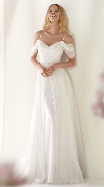 Elegant wedding dress. Ignore the soon-to-be husband, for the moment let us conc…