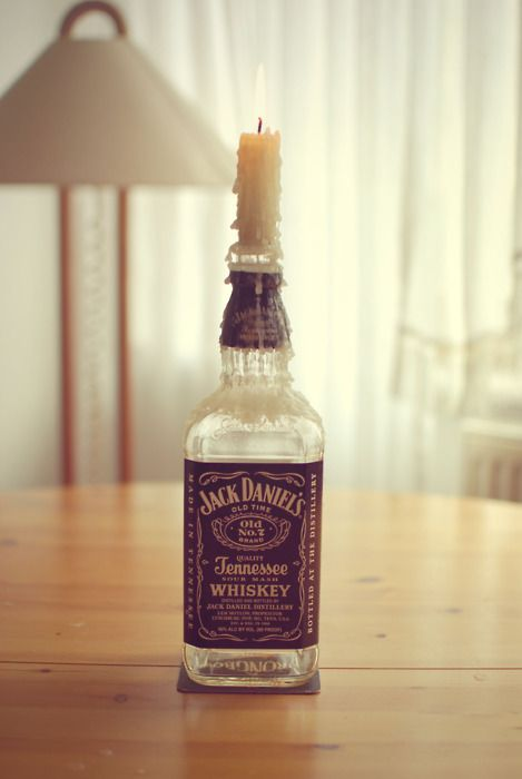 jack daniels / candle holder / center piece for Saturday. This could be accented with hay, gold and a small cactus