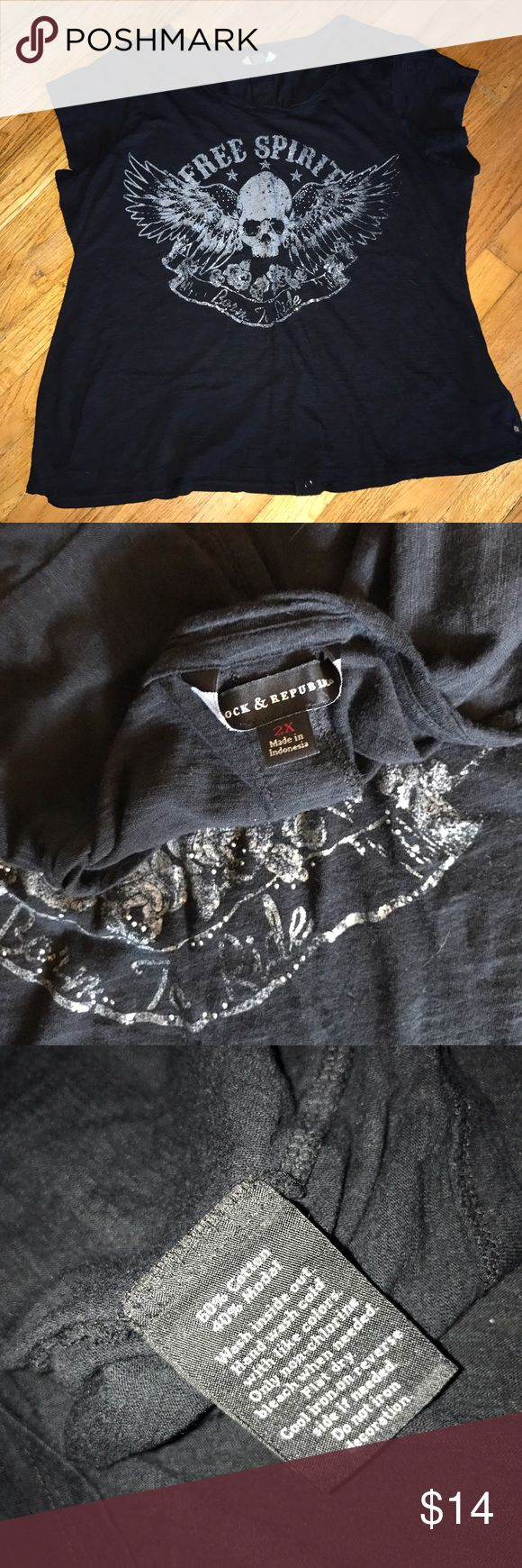 """Rock & Republic Short sleeve top size 2X Black short sleeve tee.  Snap button up back.  Skull with shimmering silver letters saying Free Spirit across top.  Very light and airy.  Armpit to armpit 23"""", length 26"""" flat.  Made by Rock & Republic.   Size 2X Rock & Republic Tops Tees - Short Sleeve"""
