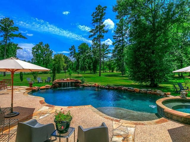 Saltwater pool with rock waterfall & spa!  31019 Edgewater Dr, Magnolia Property Listing
