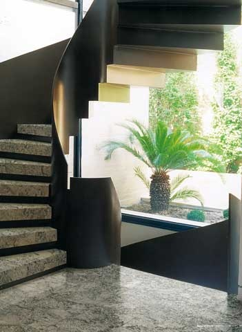 Effortlessly elegant, #granite is an obvious choice for the treads of this spiral #staircase. #UnionTiles