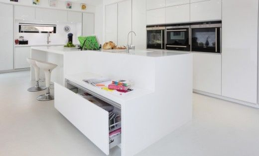 This kitchen island from Earle & Ginger has a regular height surface for adults as well as a lower worktop and seating area for kids.