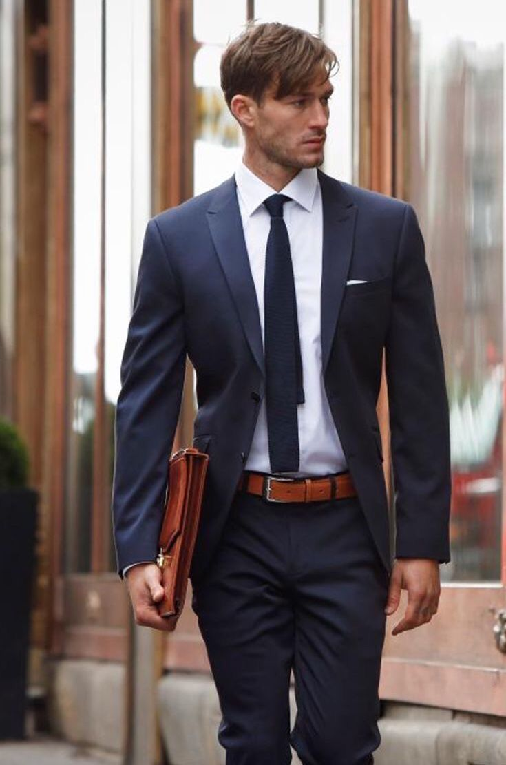 bd8a53326c07 Simple suit combo inspiration with a navy suit white button up shirt navy knit  tie navy lined white linen pocket square cognac brown leather belt brown ...