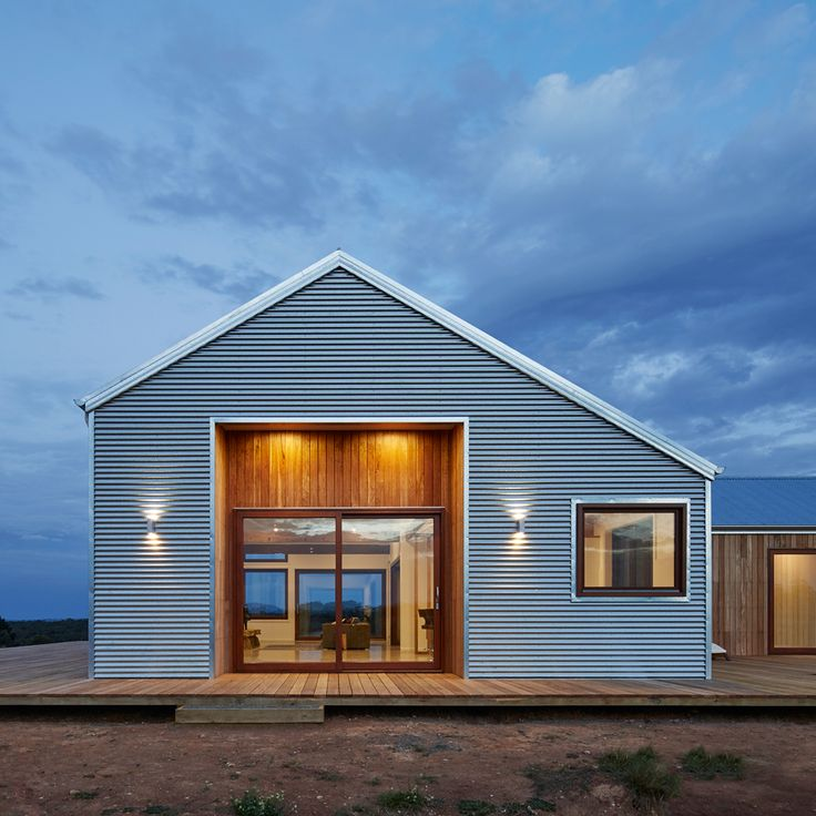 Corrugated steel provides durable facade for rural Australian home by Glow Design Group