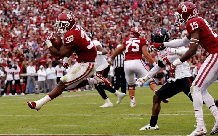 Oklahoma's Samaje Perine (32) leaps into the end zone for a score during a college football game between the University of Oklahoma Sooners (OU) and the Texas Tech Red Raiders at Gaylord Family-Oklahoma Memorial Stadium in Norman, Okla., on Saturday, Oct. 24, 2015. Photo by Steve Sisney, The Oklahoman