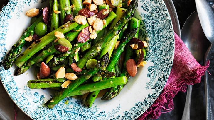 Take a culinary journey to Spain with delicious in-season asparagus served tapas-style. Alteratively, instead of using olives and almonds in this dish, you can use preserved anchovies or fried capers.
