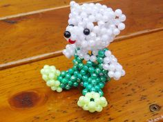 glass beads miniature animals - Google Search