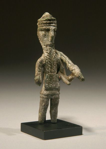 Sardinian bronze warrior, 8th century B.C. With elaborate headdress, part of bow over shoulder, quiver on back, 8 cm high. Private collection   Ex Swiss private collection.   Prehistoric Nuraghic Period, ca.