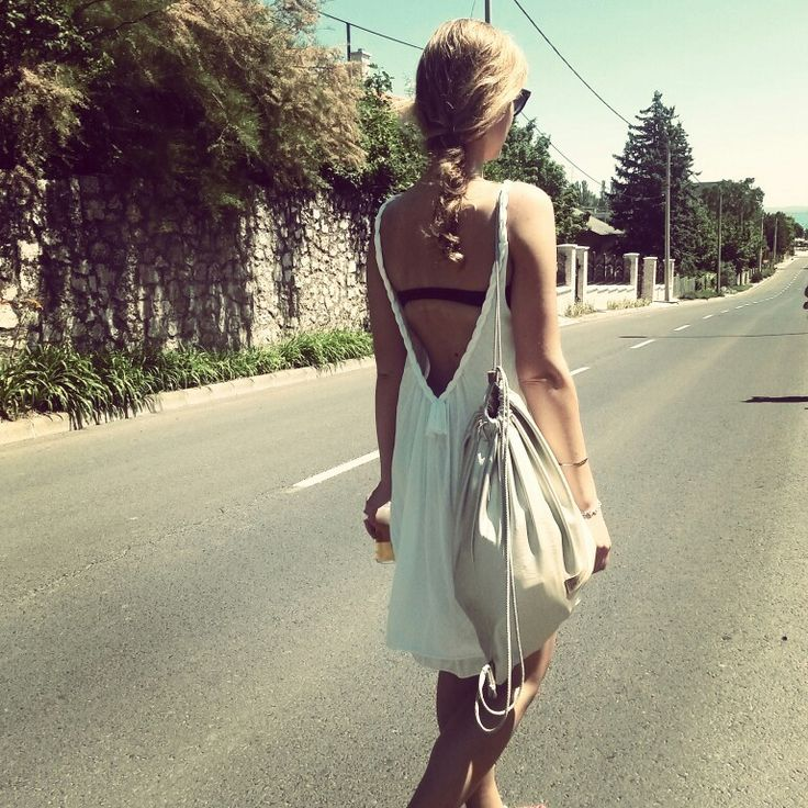 Walking down the street :) with gold backpack