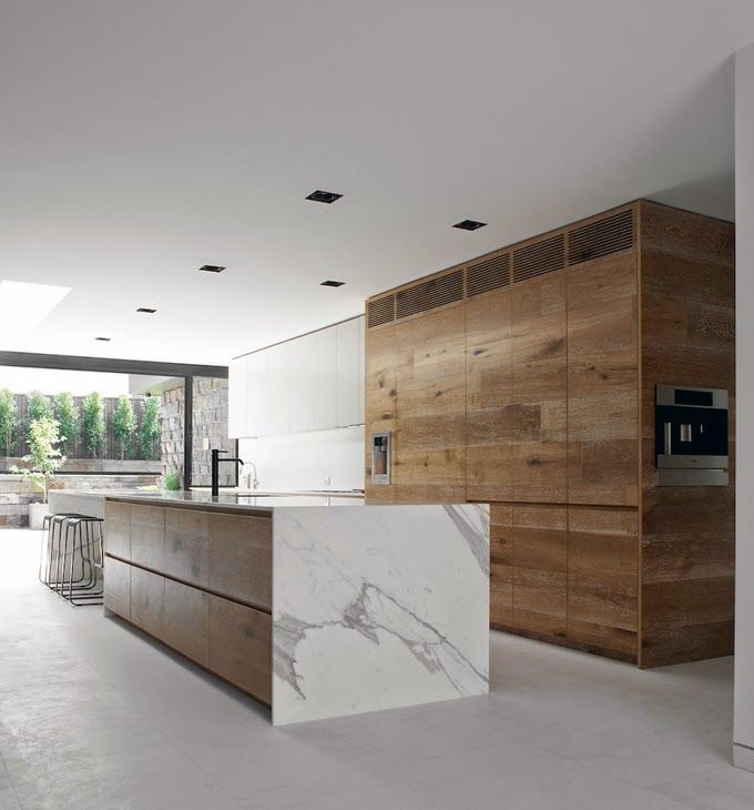 Mark - Some use of white here to break up the timber. I really like this kitchen with the combo of what and timber with the concrete floor