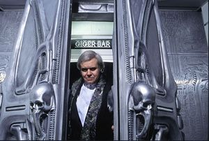 HR Giger at the entrance to the Giger bar in Chur Switzerland.