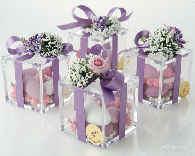 High quality Plexiglas small box with three different varieties of confetti candies, silk ribbon, hand-made flower composition.