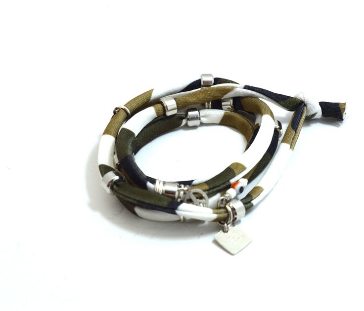 Green lycra military cord embellished with metal beads and charms and handmade red evil eye charm. Length approx. 100 cm. Five (5) turns round the wrist. Adjustable bracelet, fits to all wrist sizes. Comes in a gift box. Tip: Try it as a necklace !!!! http://www.freeartstyle.com/jewellery/bracelets/140/green-military-lycra-cord-%E2%80%93-piece-symbol-detail