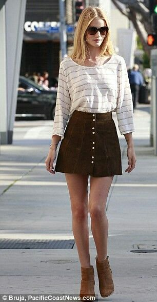Seventies chic: Rosie looked great in a suede skirt which showed off her long legs