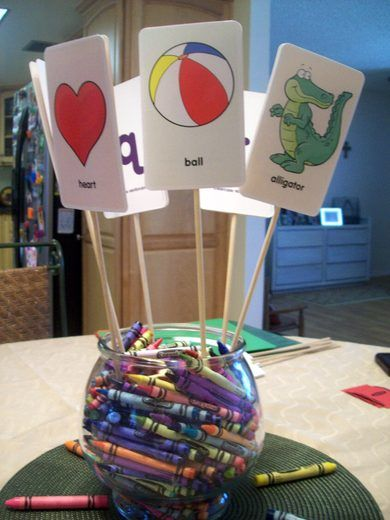 Vase with crayons could be used for a table decoration and to use to color the paper table cloth at a kids party.