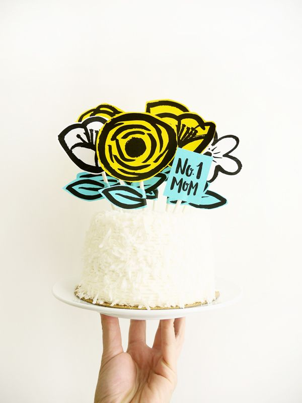 printable garden cake topper. With all the cakes I have decorated I would have never thought about crafting paper decorations for the top!  its actually very cute! and how personal could you get with this!  from ohhappyday.com