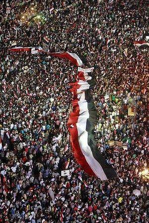 large egyptian flag flown through the crowd / tahrir square / 2013