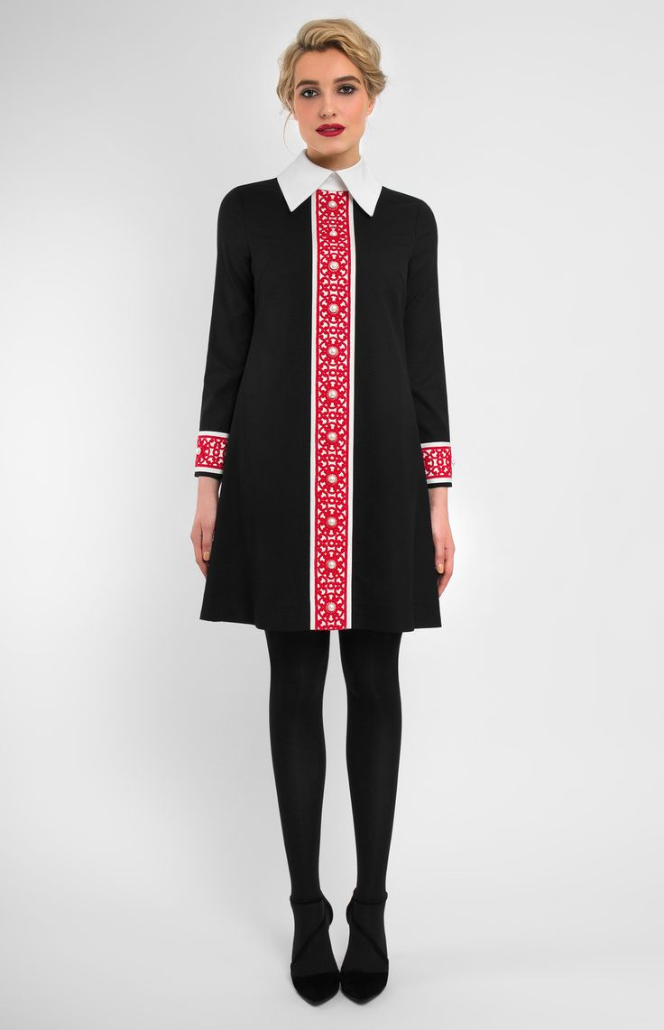 Long-sleeve A-shape genuine wool dress with lace and ribbon finish. Firm turndown collar with a collar stand. Without pockets.