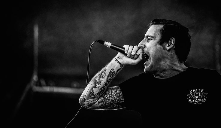 This is Winston McCall who is the lead singer of Parkway Drive. This is not the type of music that should be played in the classroom. This music projects as an in your face type of Heavy Rock I have grown up listening to. My favorite song by them is called Carrion and the link for the youtube video is https://www.youtube.com/watch?v=DhbyS1SuR7c . I like the image here for its ability to show the neck appearing to strain from singing as well as the black and white aspect of the image.