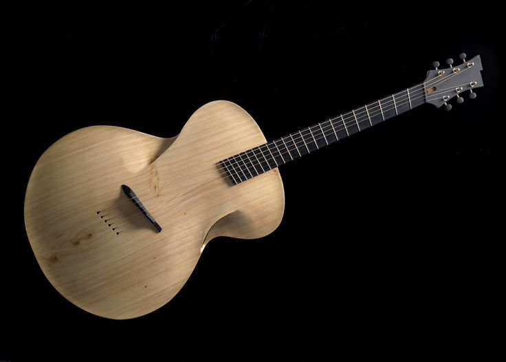 maxwellcustom:  Infinitum - The Archtop Acoustic reimagined.  Ive been studying the last year and a half this is the final guitar from last years work and now im a finalist in the Best Design Awards!!   I cant tell you much about the internal bracing its a bit hush hush but the top and back are monterey cypress and the side are New Zealand native Kauri. The cypress was harvested from my property in Clevedon.  Stay tuned for some sound recordings. --- https://www.pinterest.com/lardyfatboy/