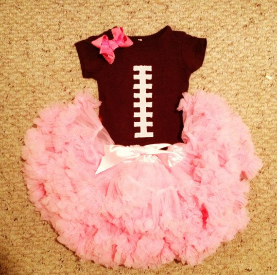 Football onesie, pink pettiskirt, and matching bow on Etsy, $40.00