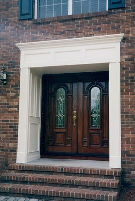 Make your home's entrance warm and inviting with detailed doors and decorative moulding fit for a palace. Who wouldn't want to come home to this?