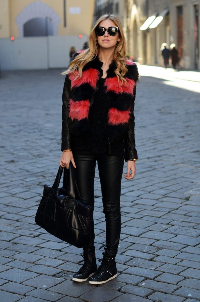 sleeveless fur jacket with leather trousers