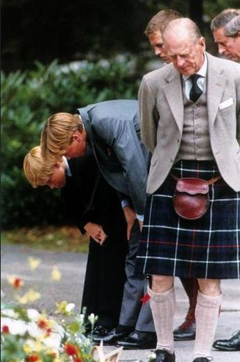 September 04, 1997: Prince Harry, Prince William, Prince Charles, Peter Phillips and HM the Queen and Prince Philip came out of the Balmoral Castle gates to view the tributes to Lady Diana.