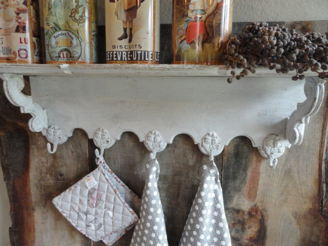 Atmospheric old wooden French Regal with Jesters cups. The shelf has a beautiful rural and graceful appearance. Five hooks up for various fun things to hang. Size 85 x 21 x 24 high.