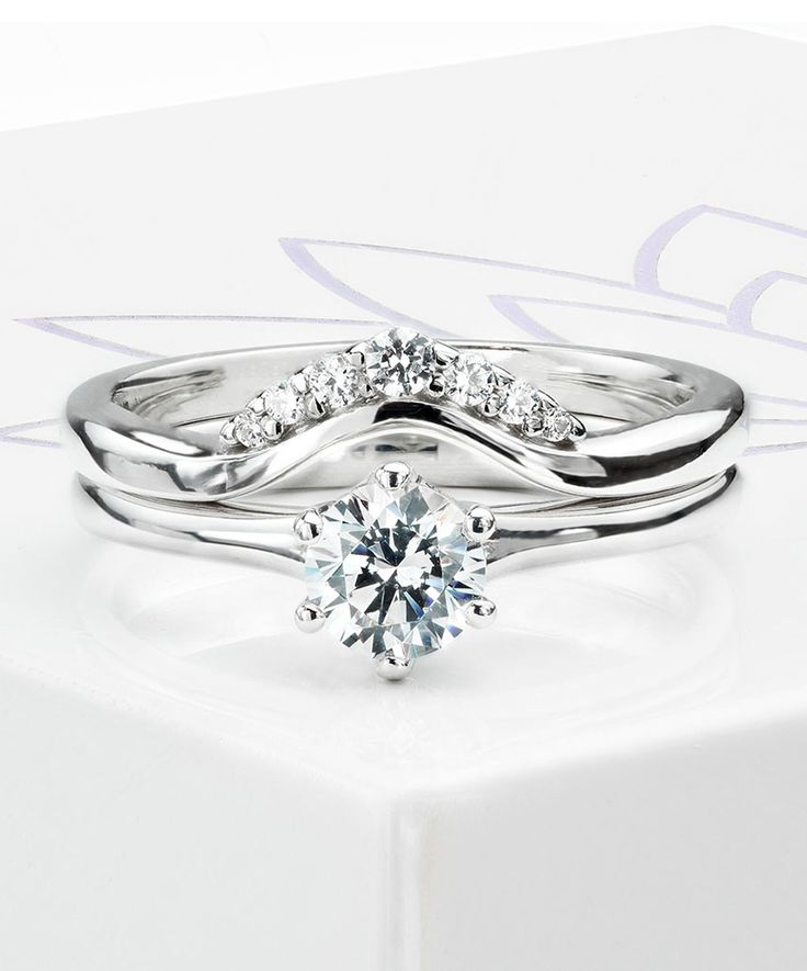 The Tiara Diamond Wedding Ring Featuring A Graduating Set Of Round Brilliant Cut Diamonds Engagement