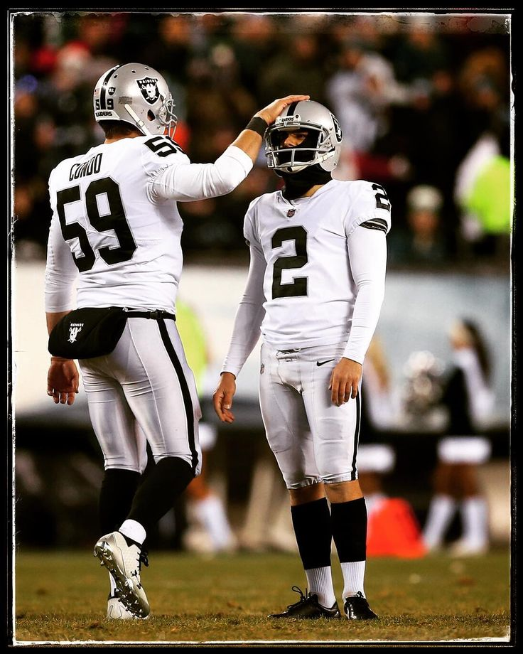 PHILADELPHIA PA - DECEMBER 25: Kicker Giorgio Tavecchio #2 of the Oakland Raiders is consoled by teammate Jon Condo #59 after missing a 48-yard field goal with 7:48 remaining in the fourth quarter against the Philadelphia Eagles during a game at Lincoln Financial Field on December 25 2017 in Philadelphia Pennsylvania. The Eagles defeated the Raiders 19-10.  @richschultznj  @gettysport . . . @espn #espn #giorgiotavecchio #joncondo #philadelphiaeagles #philadelphia #eagles #flyeaglesfly…