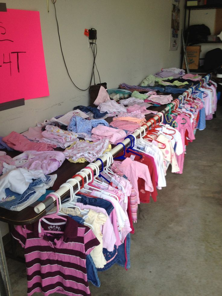 Garage Sale - Easy way to hang kid clothing and not take up any extra space.