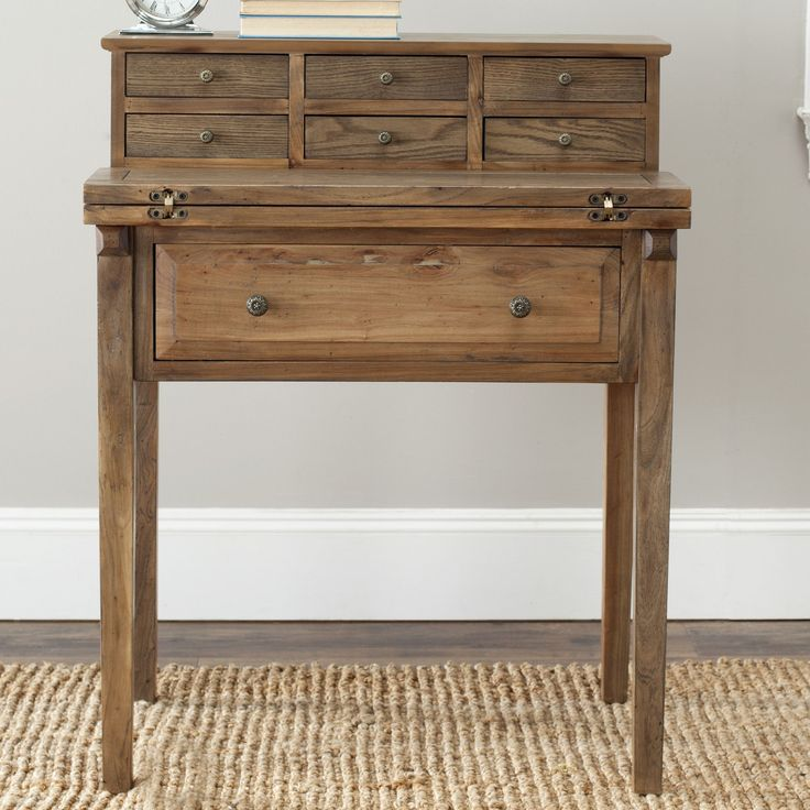 Features:  -Crafted of pine.  -Fold down style.  -Made for small spaces.  -7 Drawers.  -The drawers need to be attached to the surface of the desk.  -Back material: Wood.  Desk Type: -Secretary / Roll