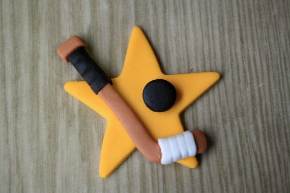 Hockey Stick and Puck Cupcake Toppers so cute gonna use this for my nephew's birthday party toppers @Becky Lowe